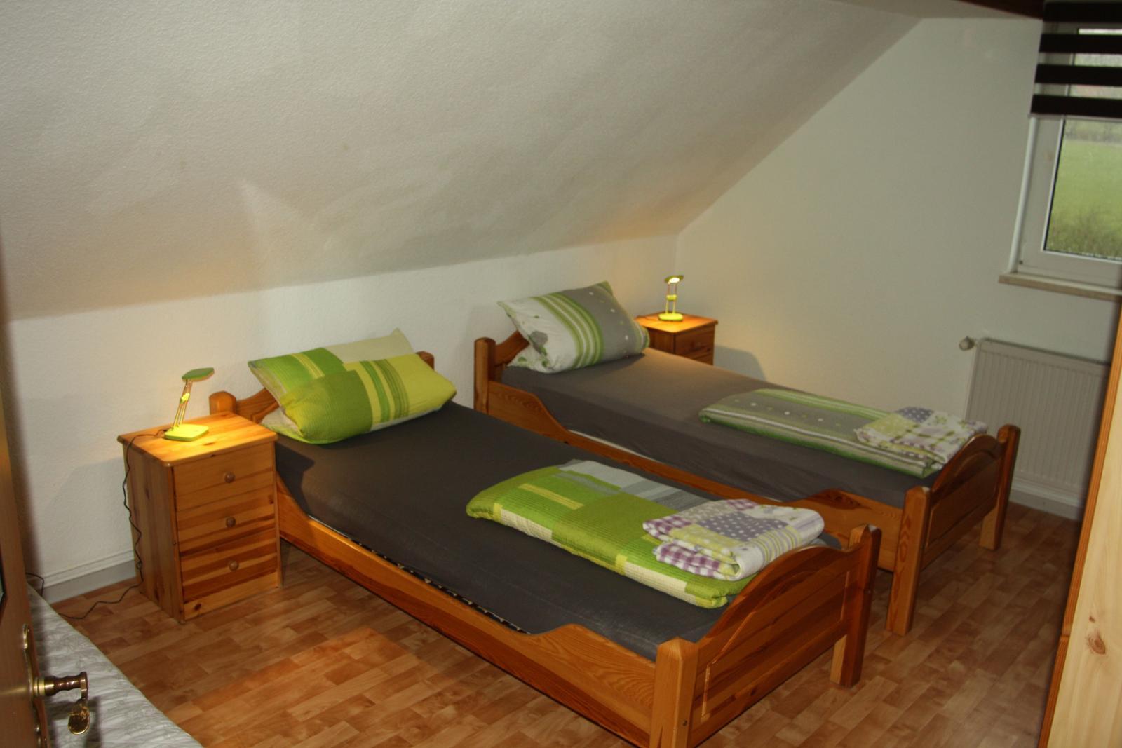 0247-20 Ferienhaeuser Rieger Ferienwohnung Schlafzimmer