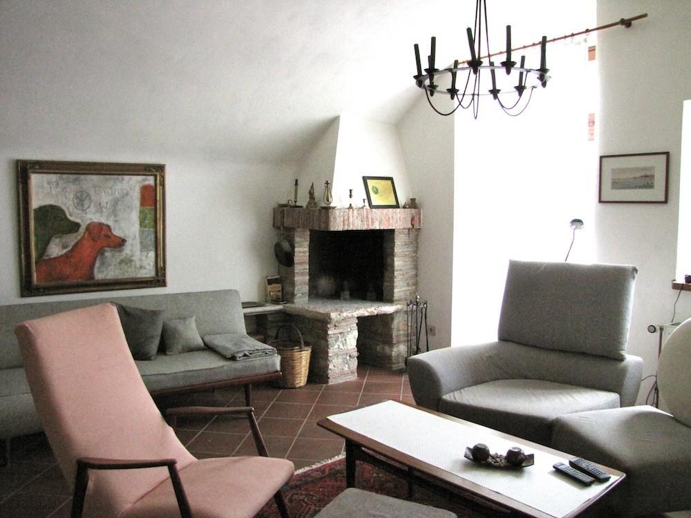 0551-05 Ferienhaus Rustico Bell Aria Wohnzimmer mit Kamin