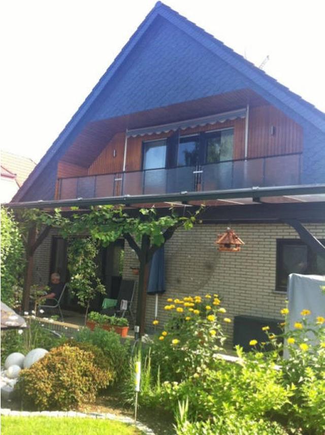 0570-02 Ferienwohnung Poczewski Aussenansicht mit Garten