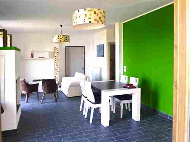 0607-04 Ferienhaus Castagneto Wohnzimmer mit Essecke