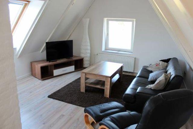 0780-04 Ferienhaus Mia Wohnzimmer Bild 1